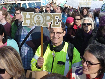 Craig Kelley with Hope sign